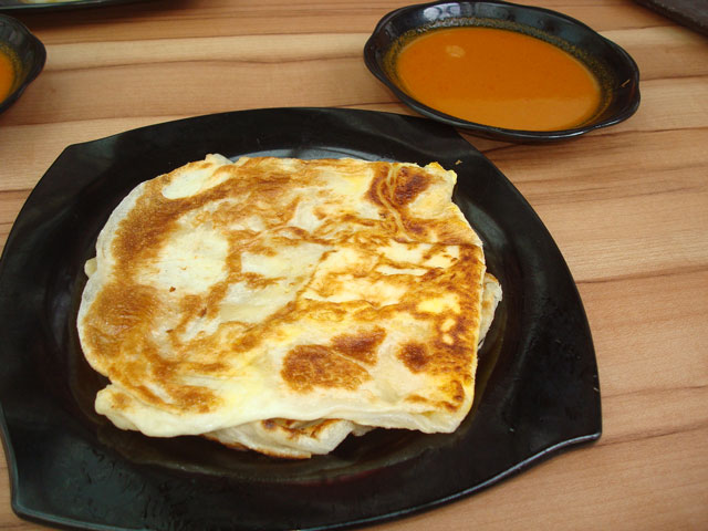 This is a plate of marvellous roti prata.